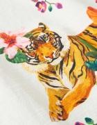 Artistic detail on kitchen tea towels.